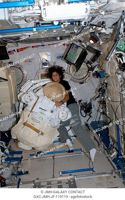 NASA astronaut Sunita Williams, Expedition 32 flight engineer, works with an Extravehicular Mobility Unit (EMU) spacesuit in the Kibo laboratory of the...