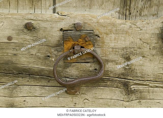 St Veran, the highest village in Europe - Old handle or knocker in iron of wood door in Queyras