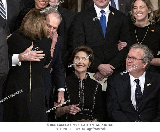 United States House Minority Leader Nancy Pelosi (Democrat of California) and former United States President George W. Bush share a hug during the ceremony...