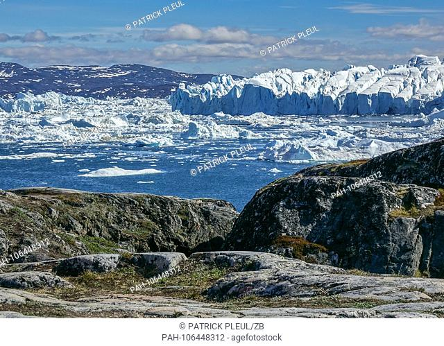 22.06.2018, Gronland, Denmark: Huge icebergs floating in the sea in front of the coastal town of Ilulissat in western Greenland