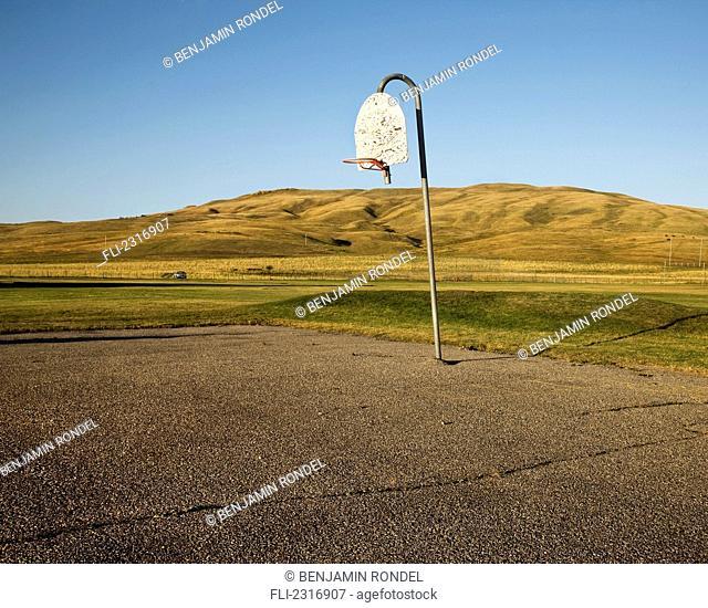 Basketball Hoop In Rural Schoolyard;Alberta Canada