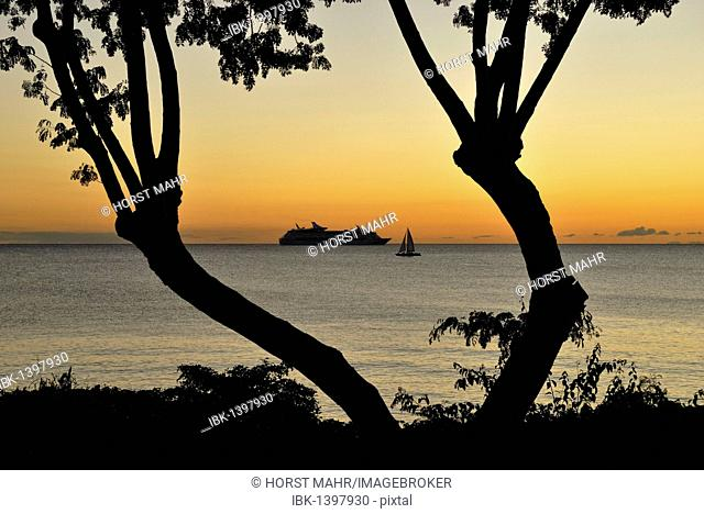 Cruise ship and a sailing ship in the late evening light, island of St. Croix, U.S. Virgin Islands, USA