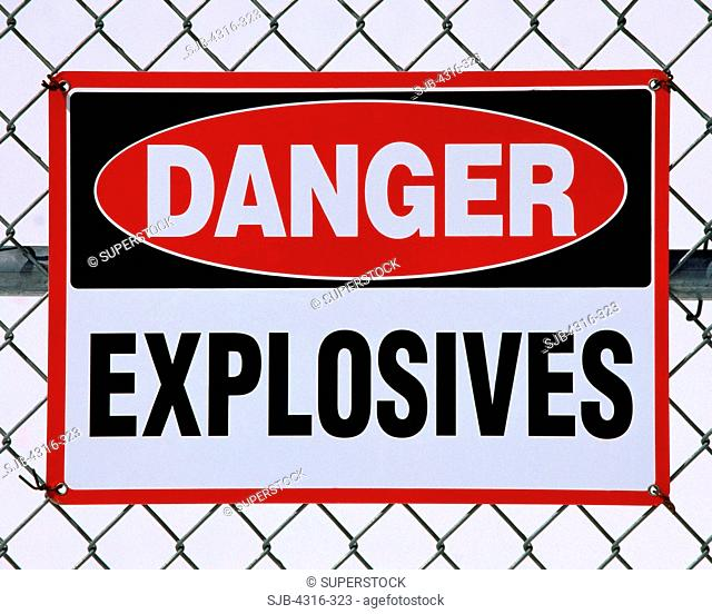 Danger Sign Indicating Explosives Lie Within the Fenced Boundary