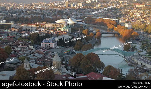 Tbilisi, Georgia. Top View Of Famous Landmarks In Autumn Evening. Georgian Capital Skyline Cityscape. Justice House, Bridge Of Peace, Concert Hall