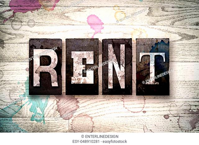 """The word """"""""RENT"""""""" written in vintage dirty metal letterpress type on a whitewashed wooden background with ink and paint stains"""