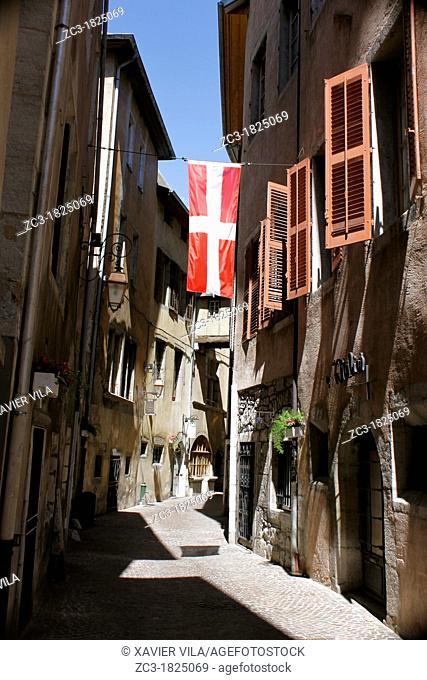 Old street with Savoyard flag near the castel of Chambéry, Savoie, Rhône-Alpes, France