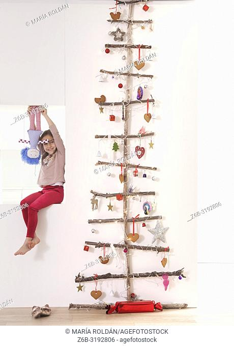 Special Christmas tree and little girl