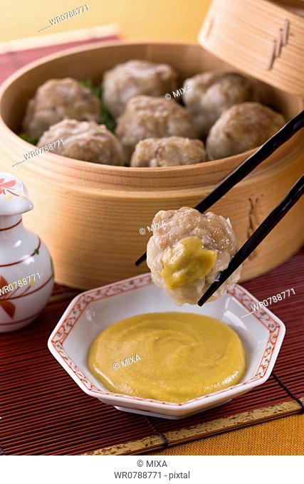 Putting Chinese Hot Mustard on Shaomai