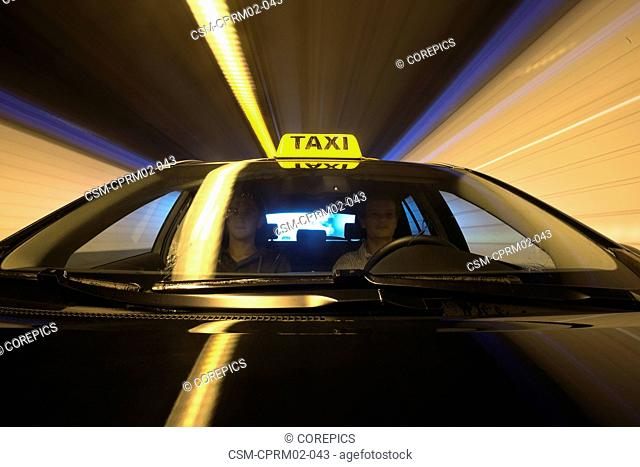 Taxi entering a tunnel, seen from the hood of the car