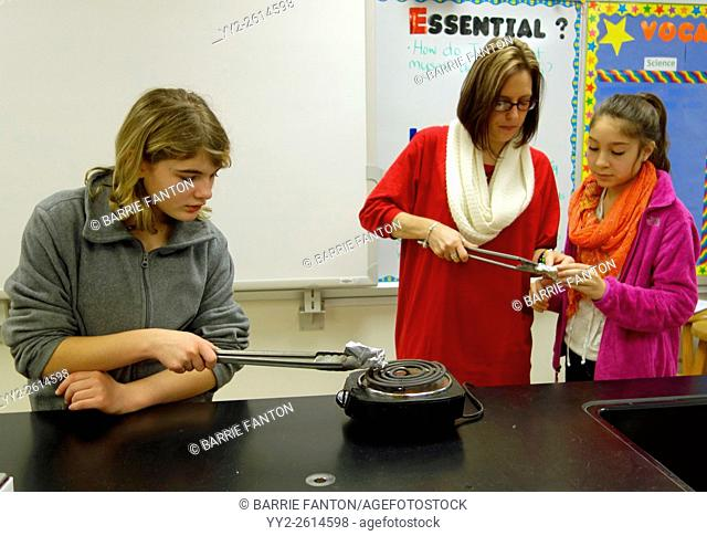 Teacher and Students Studying Chemical Reaction to Heat, Wellsville, New York, USA