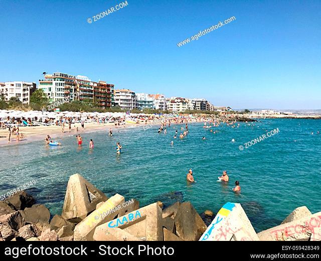 Pomorie, Bulgaria - September 18, 2017: People enjoying their time at Pomorie Beach, Bulgaria