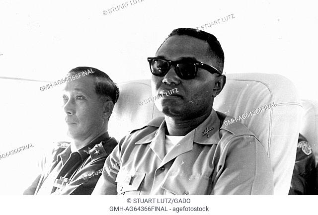 African-American United States Army Lieutenant AL Walker sitting beside SP Col Sangad in a transport during the Vietnam War