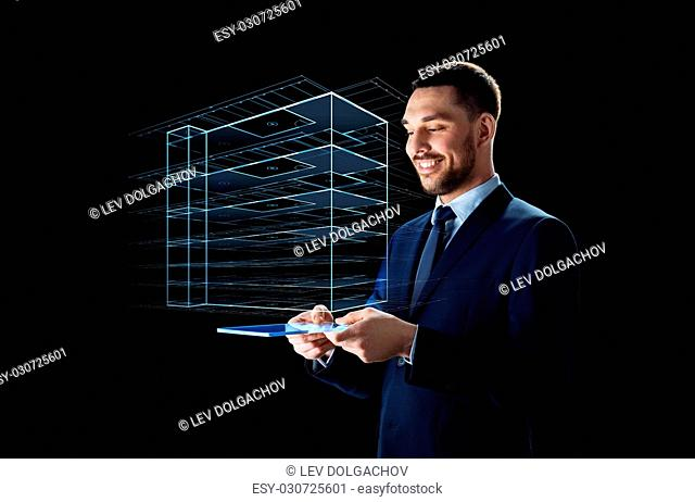 business, people and future technology concept - smiling businessman in suit working with transparent tablet pc computer and virtual construction hologram over...