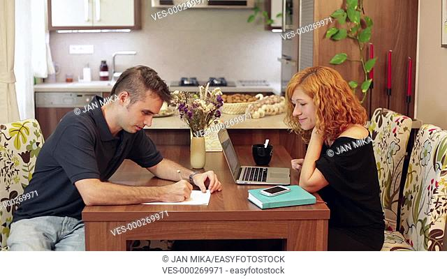 Young couple working from home. Home office concept