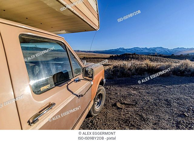 Campervan parked in desert, Sierra Nevada, Bishop, California, USA