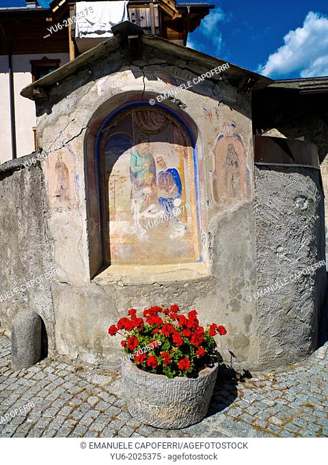 Antique painting on a street in Bormio, Lombardy, Italy