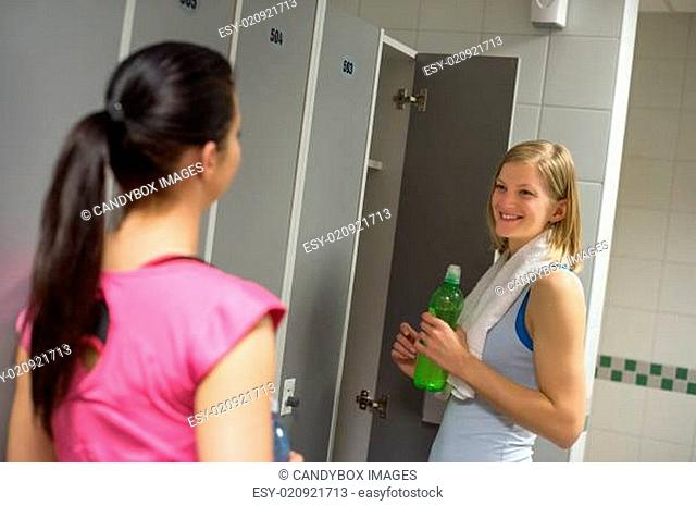 Woman talking with friend in changing room