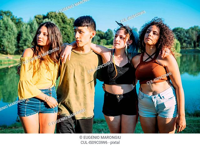 Friends posing by lake