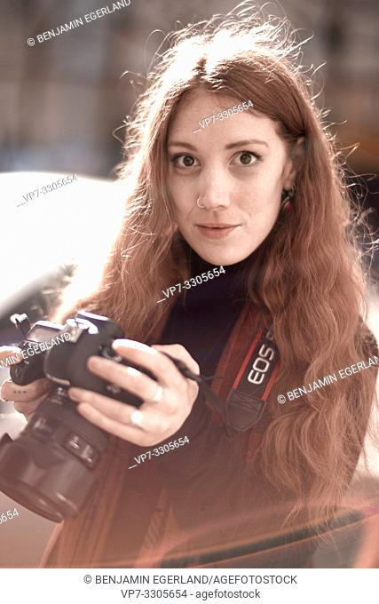 Young woman with DSLR camera, in Berlin, Germany