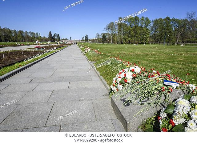 St. Petersburg, Russia - At the entrance to the Piskaryovskoye Memorial Cemetery in Leningrad (present day St. Petersburg) this granite structure contains an...