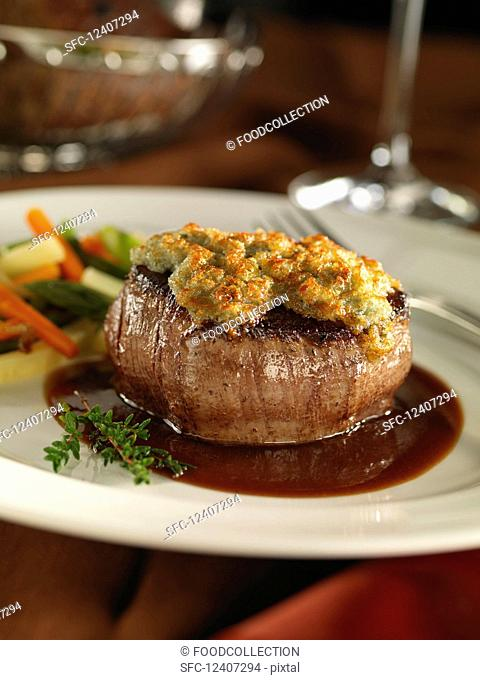 A beef medallion topped with Roquefort cheese