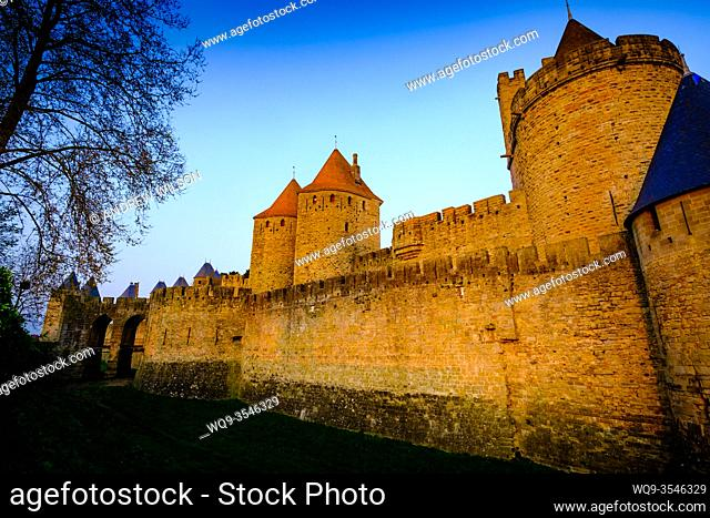 Just after dawn the first rays of sunlight glance across the walls and turrets of the medieval Cité de Carcassonne in southern France