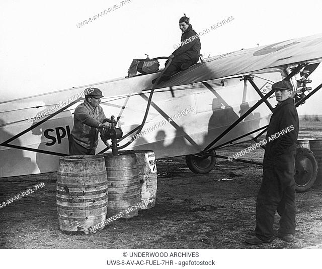 Roosevelt Field, New York: December 22, 1927.Mechanics pumping 500 gallons of fuel into the Fokker monoplane Splitdorf which Bert Acosta and Emile Burgin will...
