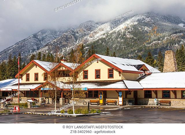 Banff Railway Station set against a backdrop of the Rocky Mountains after the first light snowfall of the season