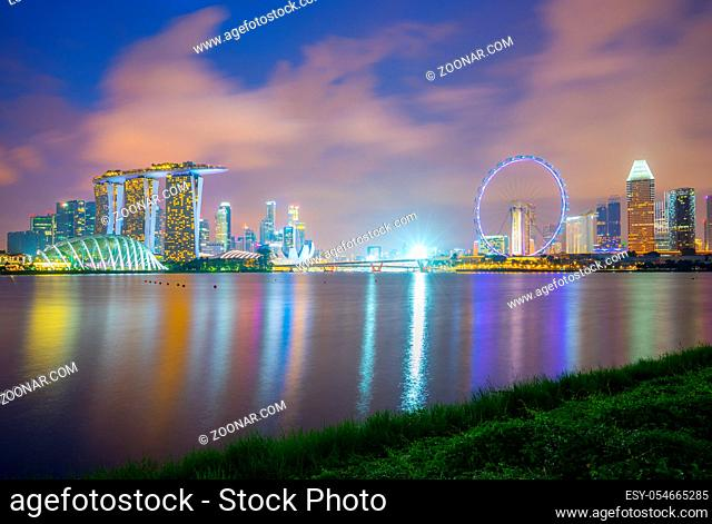 Singapore city skyline at night view from Marina Barrage in Singapore city
