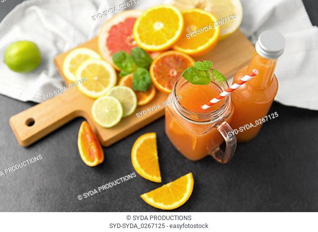 mason jar glass with juice and fruits on table