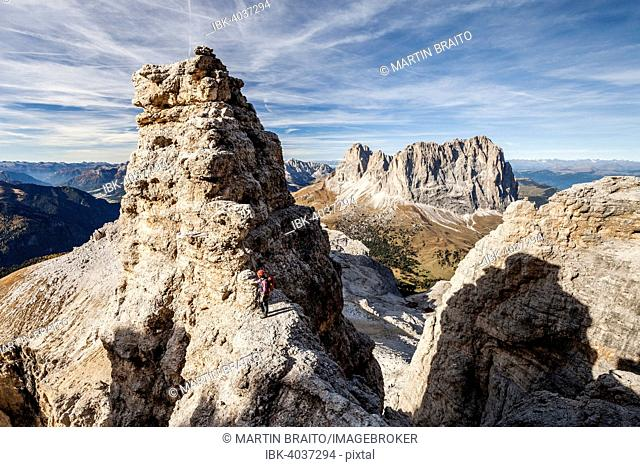 Mountaineers during the ascent of the Piz Selva on the Pößnecker vai ferrata in the Sella group at Sella Pass, behind the Sasso Lungo and Sasso Piatto