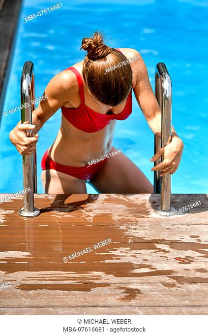 young woman in bikini, getting out of pool, El Sauzal, Tenerife, Canary Islands, Spain