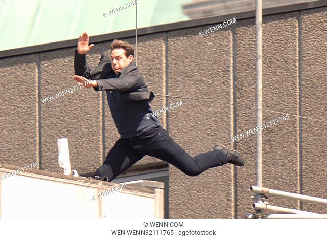 Tom Cruise leaps from the roof of one building to another while filming the next film in the 'Mission: Impossible' series; Cruise appeared to injure himself in...