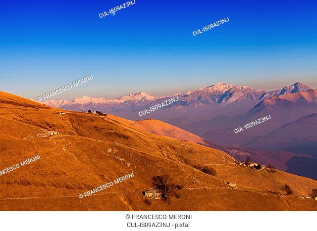 Elevated landscape with distant snow capped mountains, Monte Generoso,Ticino, Switzerland