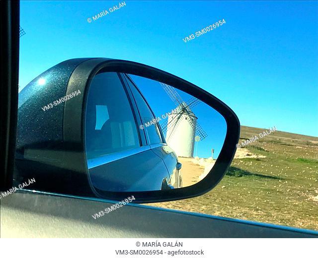 Windmill reflected on the rear view mirror of a car. Campo de Criptana, Ciudad Real province, Castilla La Mancha, Spain