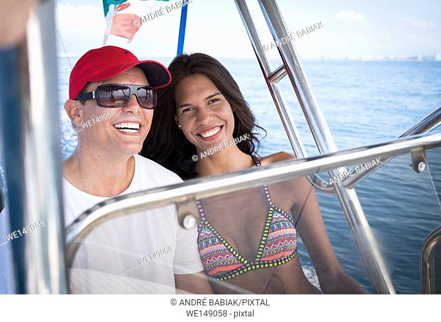 Causasian man and hispanic woman enjoying boat ride. Banderas Bay - Pacific Ocean, Puerto Vallarta, Mexico