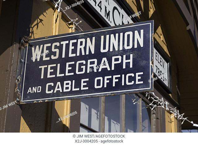 Chama, New Mexico - A Western Union Telegraph sign on the Cumbres & Toltec Scenic Railroad station. Western Union provided telegram service from 1851 until 2006