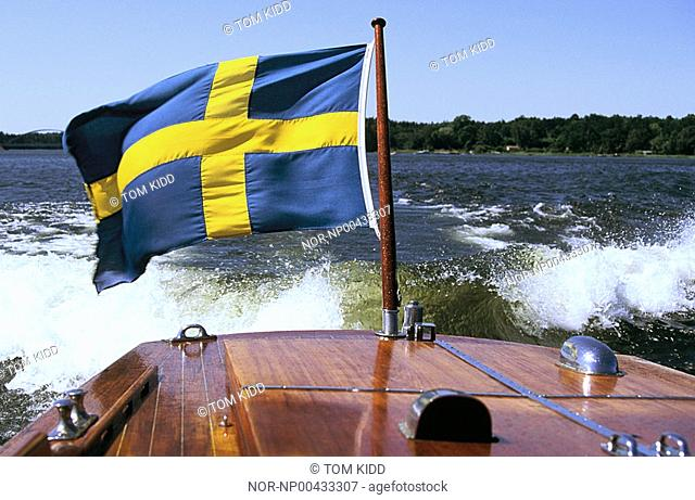 A speed boat with the Swedish flag in Scandinavia