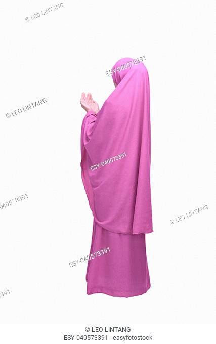 Portrait of asian muslim woman praying to god posing isolated over white background