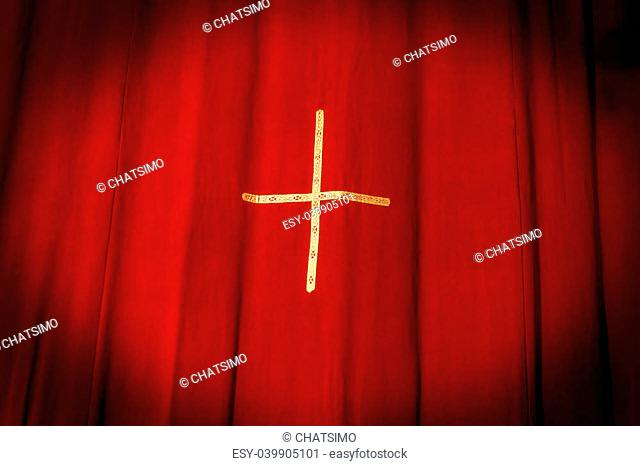 Red curtains with yellow cross in the middle