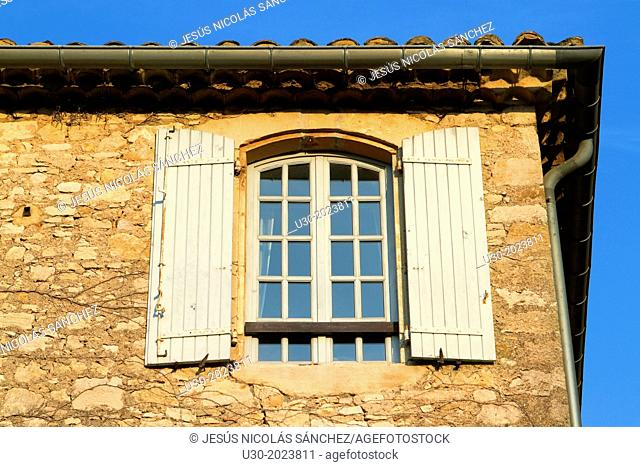Detail of a typical facade with window in Roque-sur-Ceze, labelled The Most Beautiful Villages of France. Gard deparment, Languedoc-Roussillon region