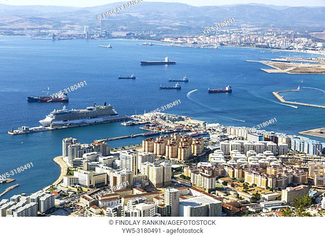 High view over Gibraltaharbour with a cruise liner berthed at Western Arm of Container Quay, and a view over the Bay of Gibraltar to the Spanish mainland