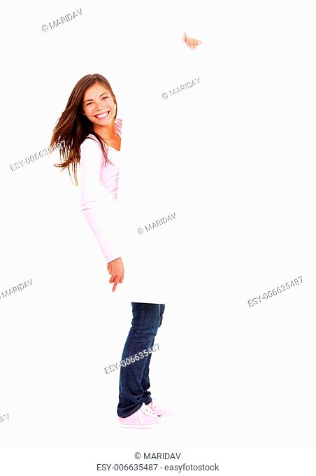 Beautiful woman holding sign. Dynamic full length image of woman holding a white blank board / placard. Beautiful mixed race chinese / caucasian model