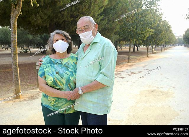 elderly couple walking in the afternoon in the park