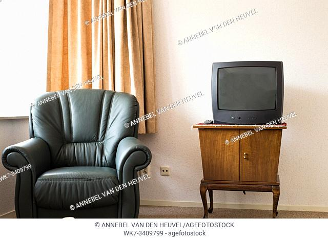Vintage Television on wooden antique closet, old design in the living room