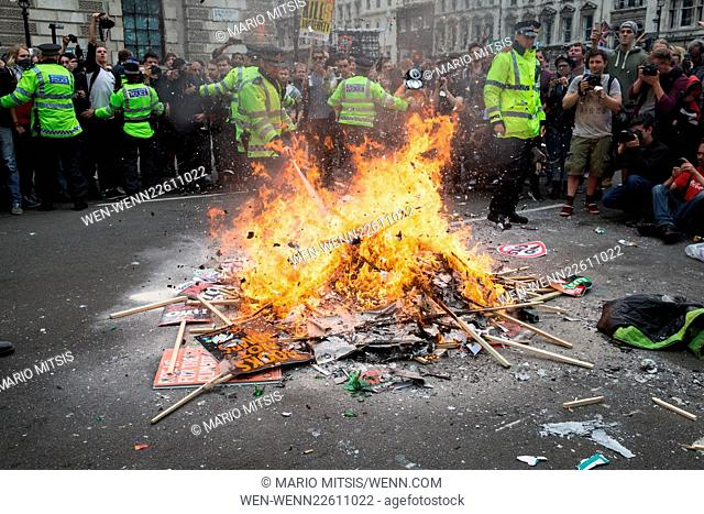Protesters light a bonfire during the People's Assembly Anti-Austerity March in Central London Featuring: Atmosphere Where: London