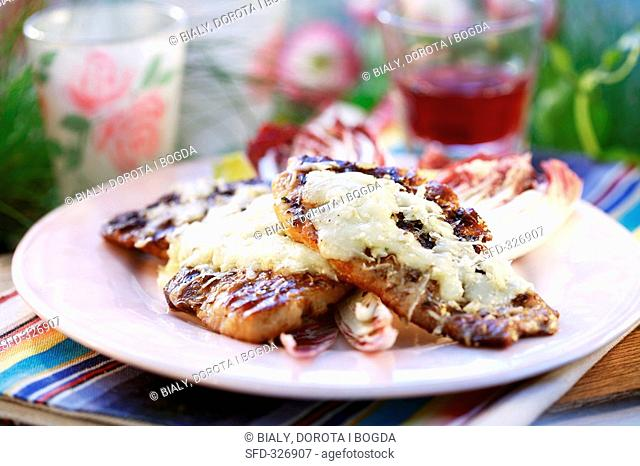 Grilled ham slices with cheese on radicchio