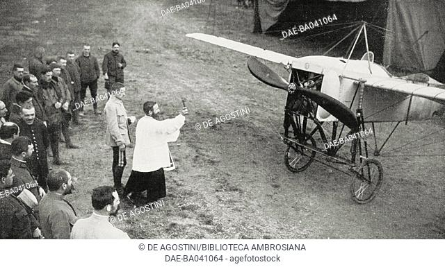 A priest blessing a French aeroplane, France, World War I, photo by Roll from L'Illustrazione Italiana, Year XLII, No 22, May 30, 1915