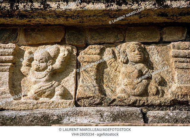 Vamana in bas-relief at the Raja Vaishyabhujanga Mandapaya or the Council Chamber, built by king Parakramabahu. Ancient City of Polonnaruwa