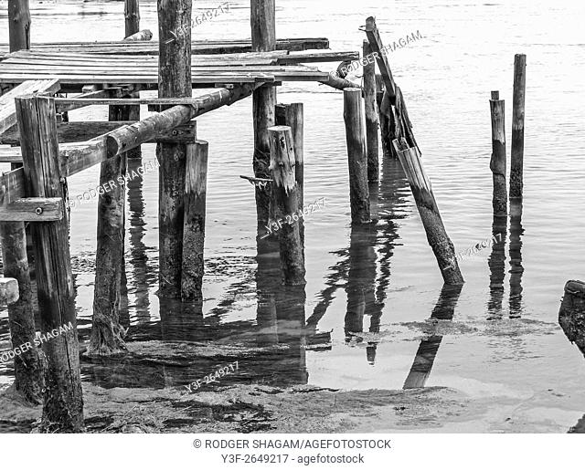 An old pier seems ready to collapse into the estuary at low tide. Berg River, Western Cape Province, South Africa